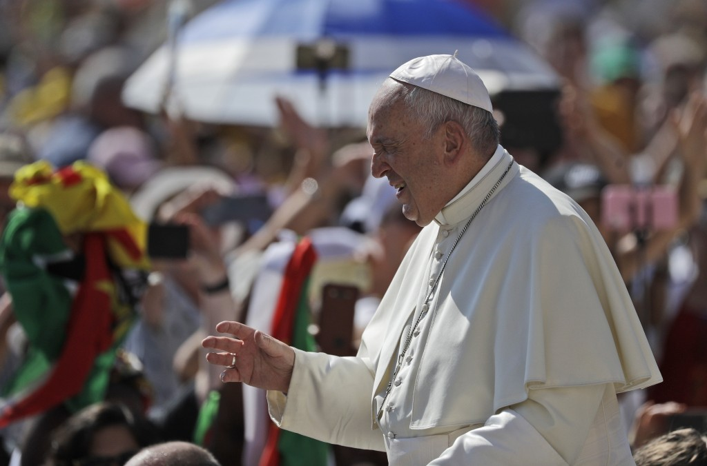 Pope Francis squints his eyes in the sunlight as he arrives for his weekly general audience in St. Peter's Square, at the Vatican, Wednesday, June 26,...