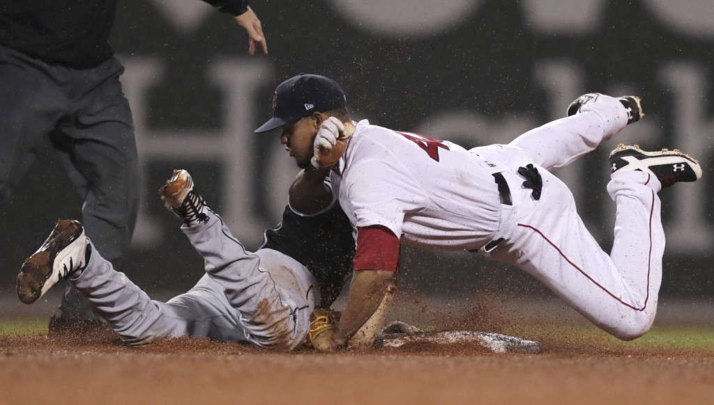 Boston Red Sox second baseman Marco Hernandez, right, collides with Chicago White Sox's Tim Anderson, who was caught trying to advance to second on hi...