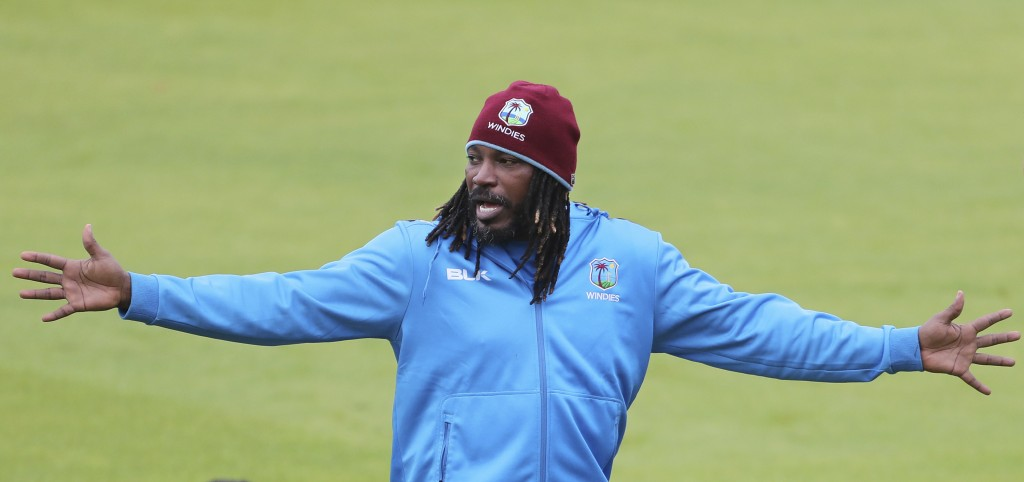 West Indies' Chris Gayle gestures to his teammates during a training session ahead of their Cricket World Cup match against India at Old Trafford in M...