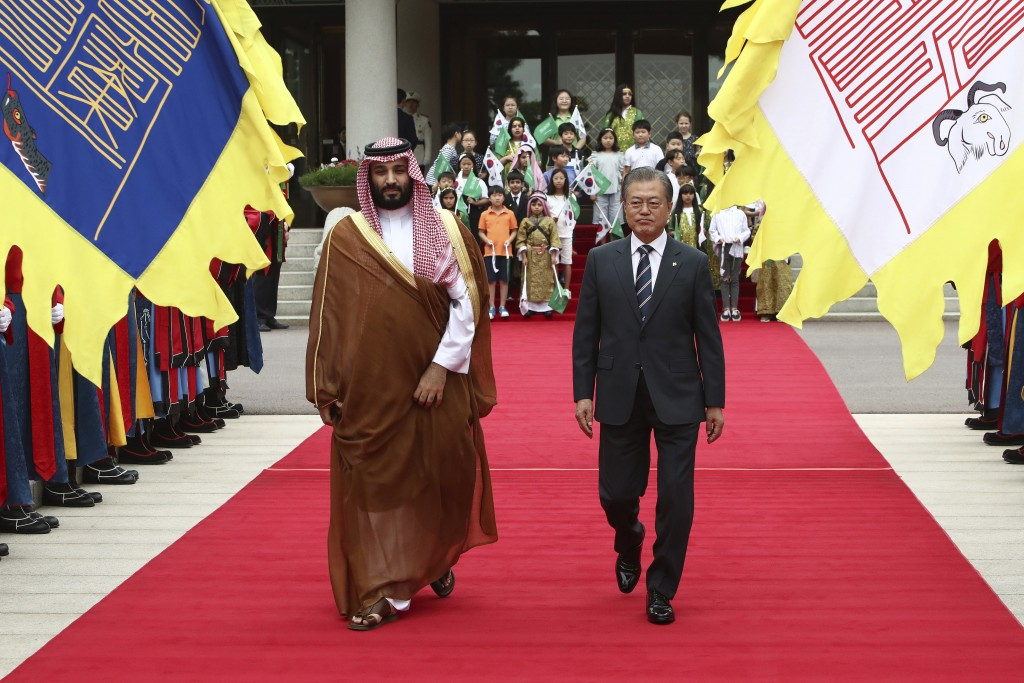 CORRECTS DAY South Korean President Moon Jae-in, right, and Saudi Crown Prince Mohammed bin Salman view an honor guard during a welcoming ceremony at ...