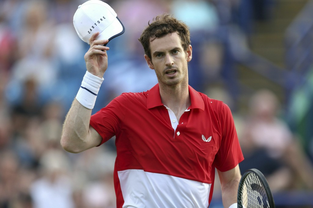 Britain's Andy Murray gestures after losing his Men's Doubles tennis match with partner Brazil's Marcelo Melo against Juan Sebastian Cabal and Robert ...