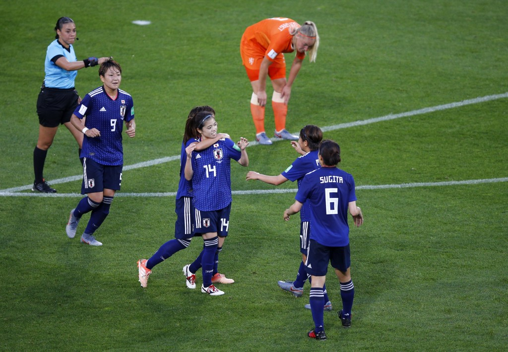 Japan's Yui Hasegawa, centre, is congratulated by teammates after scoring her team's first goal during the Women's World Cup round of 16 soccer match ...
