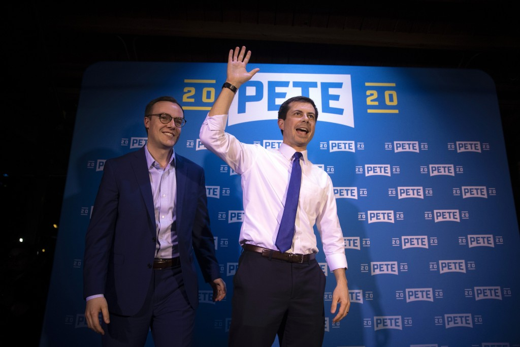 FILE - In this May 9, 2019 file photo, Democratic presidential candidate Pete Buttigieg, right, and husband, Chasten Glezman, acknowledge supporters a...