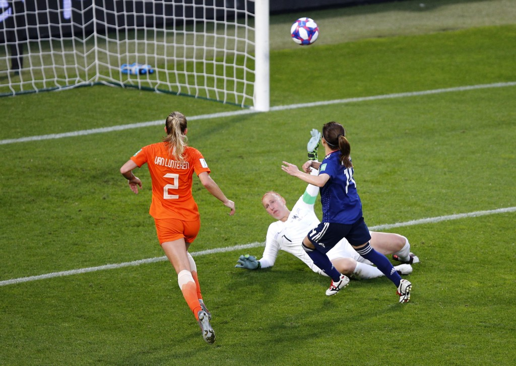 Japan's Yui Hasegawa, right, kicks the ball past Netherlands goalkeeper Sari Van Veenendaal to score her team's first goal during the Women's World Cu...