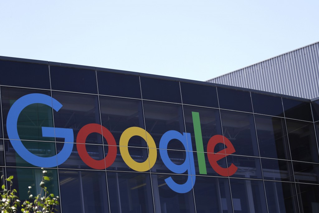 FILE - This Tuesday, July 19, 2016, file photo shows the Google logo at the company's headquarters in Mountain View, Calif. A leading French consumer ...
