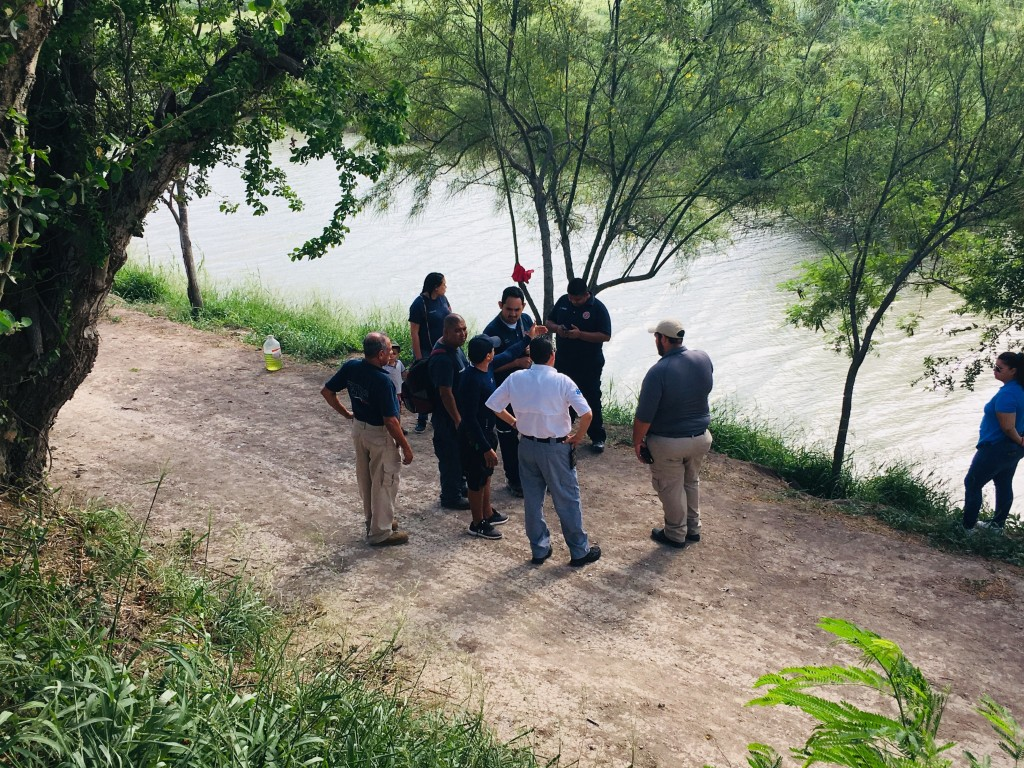 Mexican authorities stand along the Rio Grande bank where the bodies of Salvadoran migrant Oscar Alberto Martínez Ramírez and his nearly 2-year-old da...