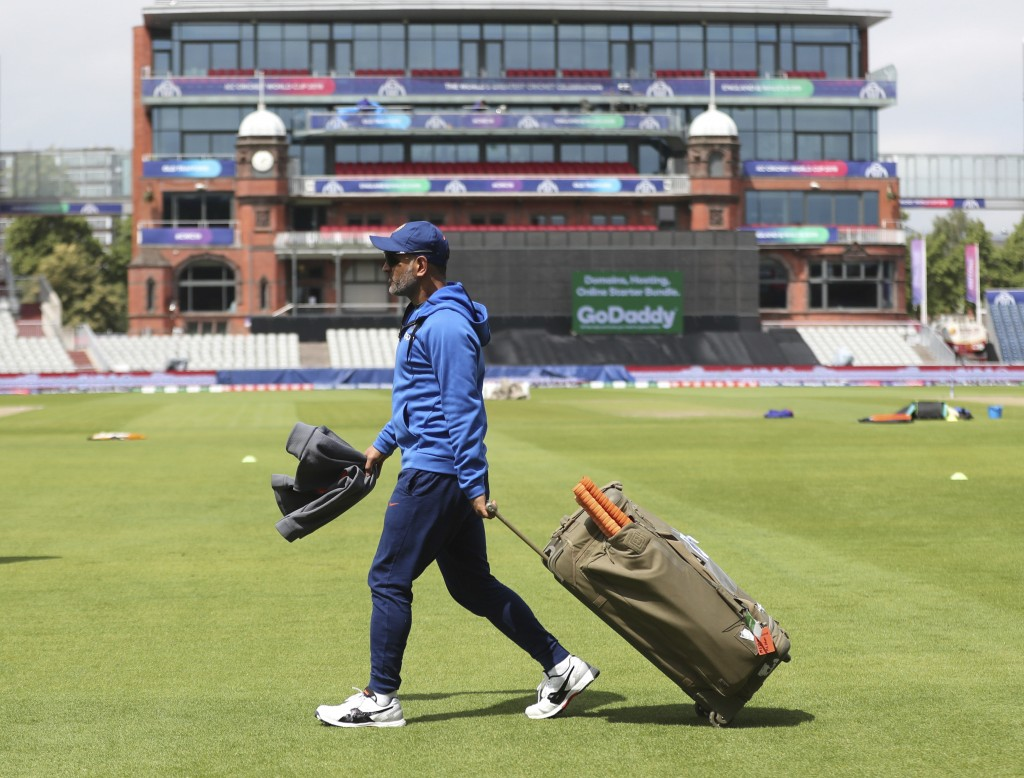 India's MS Dhoni walks to bat in the nets during a training session ahead of their Cricket World Cup match against West Indies at Old Trafford in Manc...