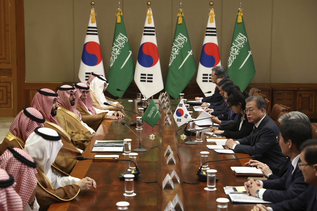 South Korean President Moon Jae-in, right, talks with Saudi Crown Prince Mohammed bin Salman, fifth left, during a meeting at the presidential Blue Ho...
