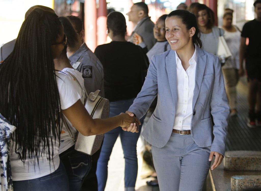 Queens district attorney candidate Tiffany Caban greets commuters Wednesday, June 26, 2019, in the Queens borough of New York. Either candidate Melind...