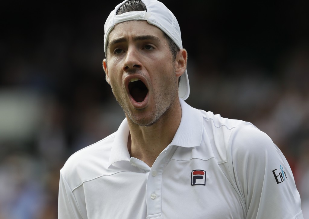 FILE - In this July 13, 2018, file photo, John Isner, of the United States, celebrates breaking serve during his men's singles semifinal against South...