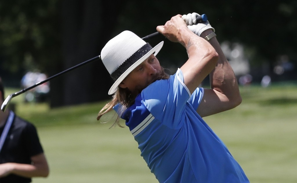Kid Rock hits from the 18th fairway during the Pro-AM for the Rocket Mortgage Classic golf tournament, Wednesday, June 26, 2019, in Detroit. (AP Photo...