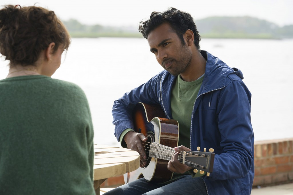 "This image released by Universal Pictures shows Lily James,, left, and Himesh Patel in a scene from ""Yesterday.""  (Jonathan Prime/Universal Pictures v..."