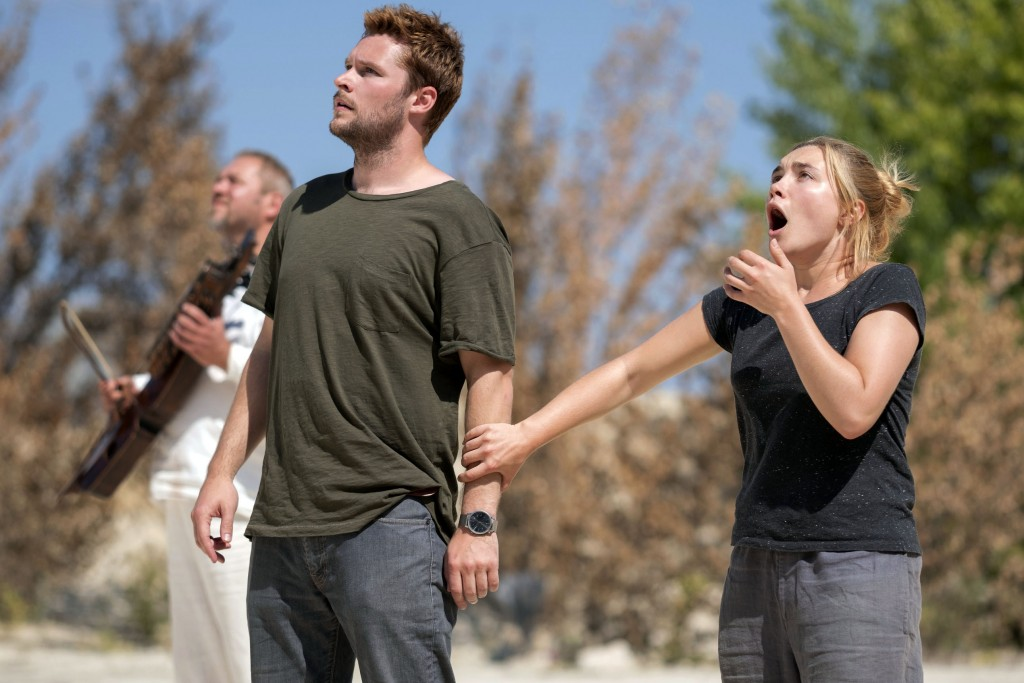 "This image released by A24 shows Jack Reynor and Florence Pugh, right, in a scene from the horror film ""Midsommar."" (Gabor Kotschy/A24 via AP)"