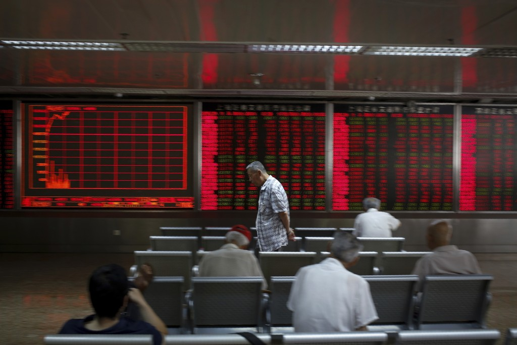 Chinese investors monitor stock prices at a brokerage house in Beijing, Thursday, June 27, 2019. Asian stocks advanced Thursday ahead of a meeting bet...