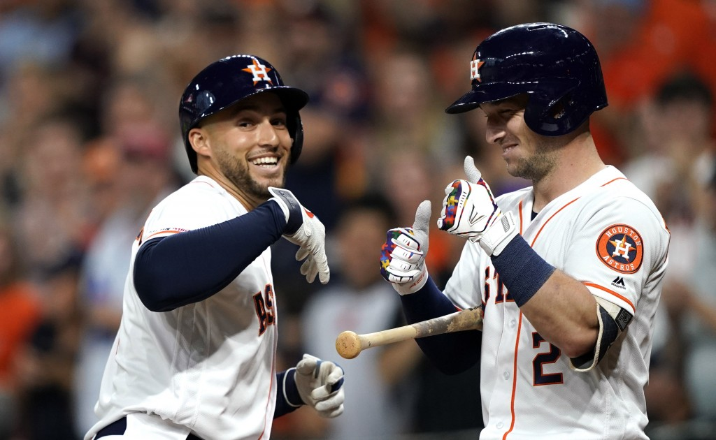 Houston Astros' George Springer, left, celebrates with Alex Bregman (2) after hitting a home run against the Pittsburgh Pirates during the first innin...