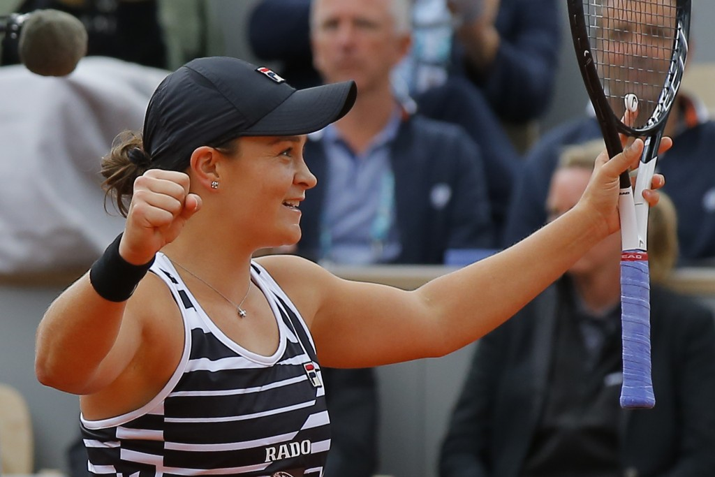 FILE - In this June 8, 2019, file photo, Australia's Ashleigh Barty celebrates after winning her women's final match of the French Open tennis tournam...