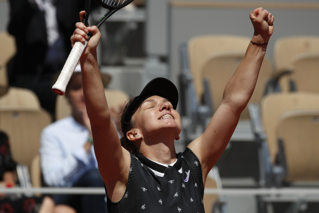 FILE - In this June 1, 2019, file photo, Romania's Simona Halep celebrates winning her third round match of the French Open tennis tournament against ...