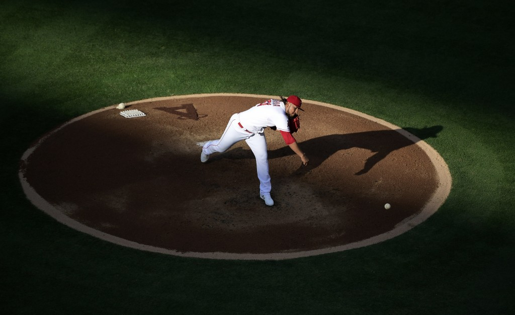 Los Angeles Angels starting pitcher Jaime Barria throws to the plate during the first inning of a baseball game against the Cincinnati Reds Wednesday,...