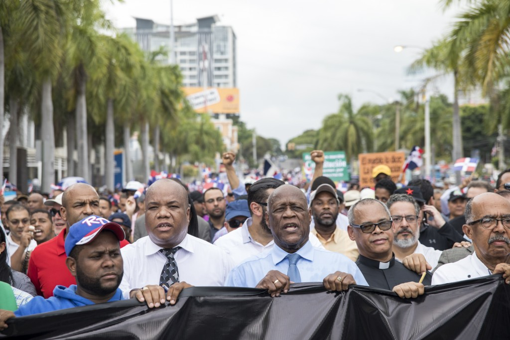 People protest a constitutional reform that would allow President Danilo Medina a third term in office as they march in front of Congress in Santo Dom...