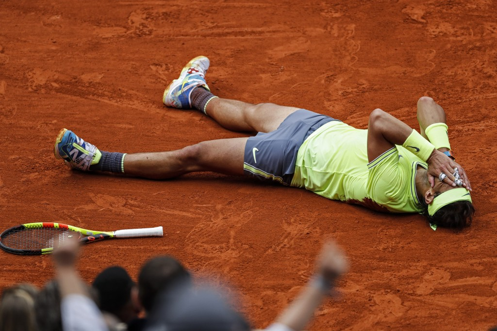 FILE - In this June 9, 2019, file photo, Spain's Rafael Nadal celebrates his record 12th French Open tennis tournament title, after winning the men's ...