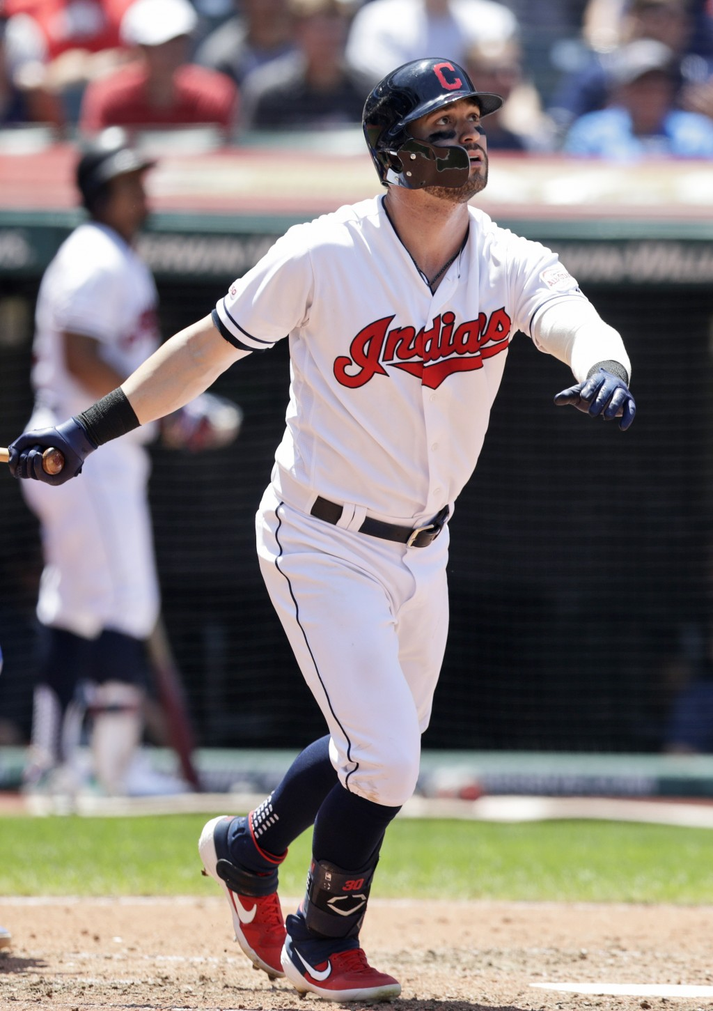 Cleveland Indians' Tyler Naquin watches his ball after hitting a solo home run in the fourth inning in a baseball game against the Kansas City Royals ...