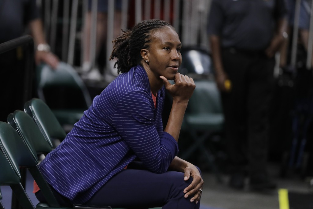 Tamika Catchings watches as the Indiana Fever play the Minnesota Lynx during the first half of a WNBA basketball game Tuesday, June 25, 2019, in India...