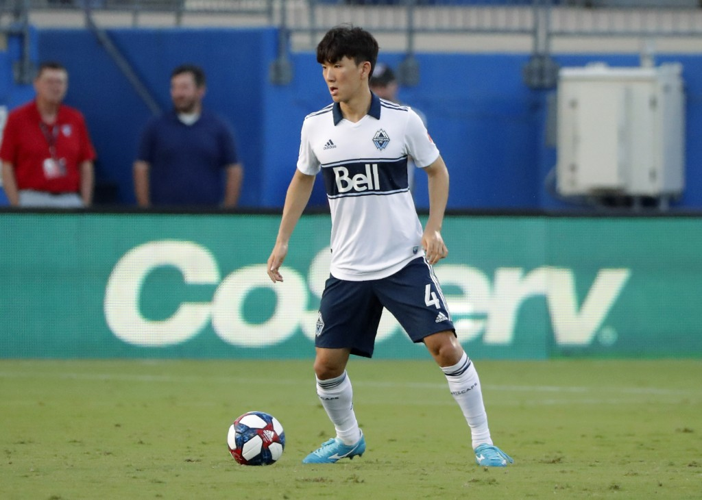 Vancouver Whitecaps' Inbeom Hwang controls the ball in the first half of the team's MLS soccer match against FC Dallas in Frisco, Texas, Wednesday, Ju...