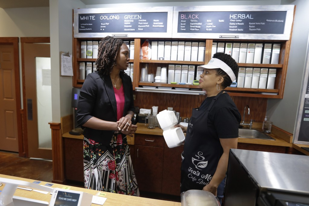 Tamika Catchings, left, talks with Joi DeFrantz at Tea's Me Cafe, Wednesday, June 26, 2019, in Indianapolis. (AP Photo/Darron Cummings)