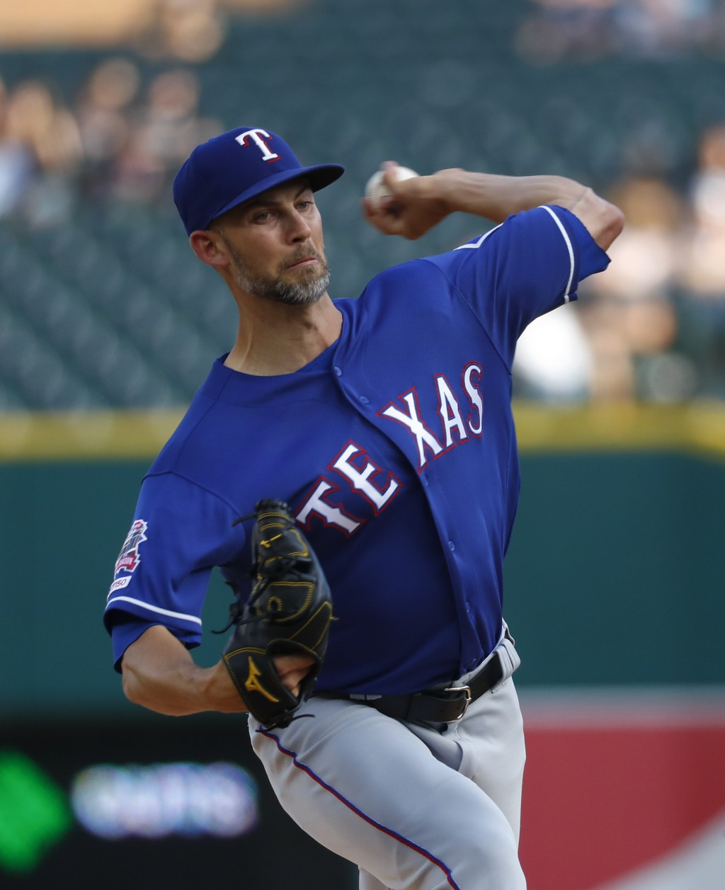 Texas Rangers pitcher Mike Minor throws against the Detroit Tigers in the first inning of a baseball game in Detroit, Wednesday, June 26, 2019. (AP Ph
