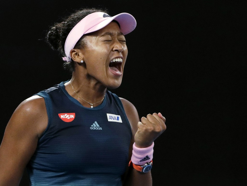 FILE - In this Jan. 26, 2019, file photo, Japan's Naomi Osaka reacts after winning the first set against Petra Kvitova of the Czech Republic during th...
