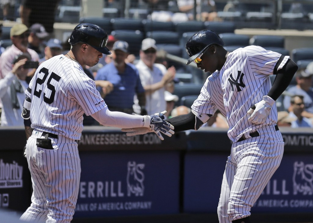 New York Yankees' Didi Gregorius, right, celebrates his solo home run with Gleyber Torres during the second inning of a baseball game against the Toro...