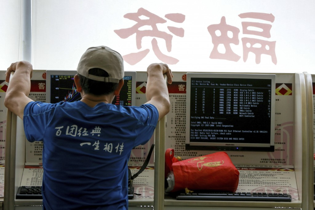 An investor monitors stock prices at a brokerage house in Beijing, Thursday, June 27, 2019. Asian stocks advanced Thursday ahead of a meeting between ...