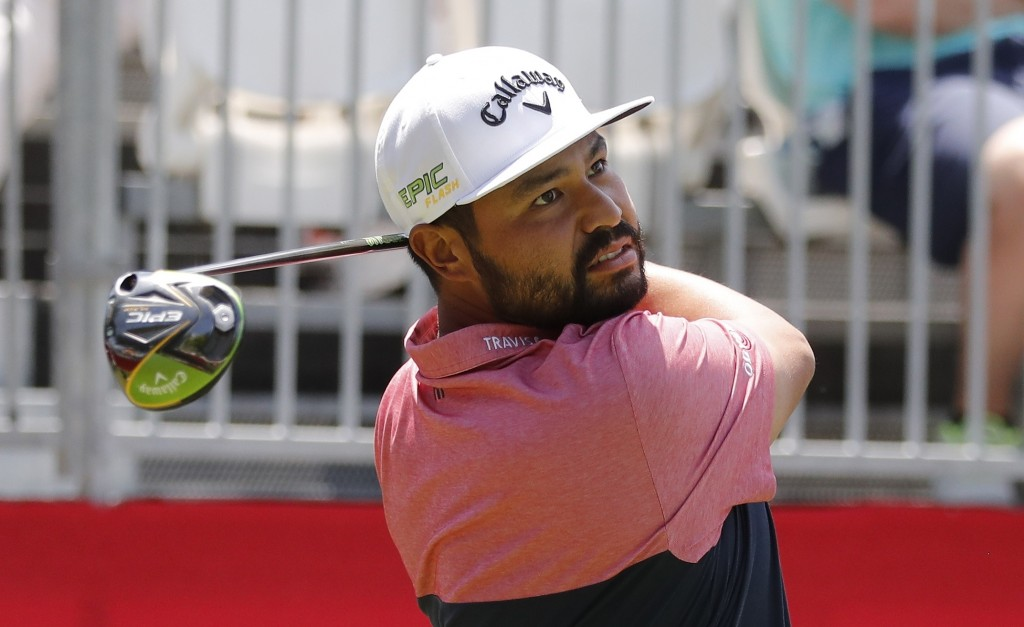 J.J. Spaun hits from the first tee during the Pro-Am at the Rocket Mortgage Classic golf tournament, Wednesday, June 26, 2019, in Detroit. (AP Photo/C...