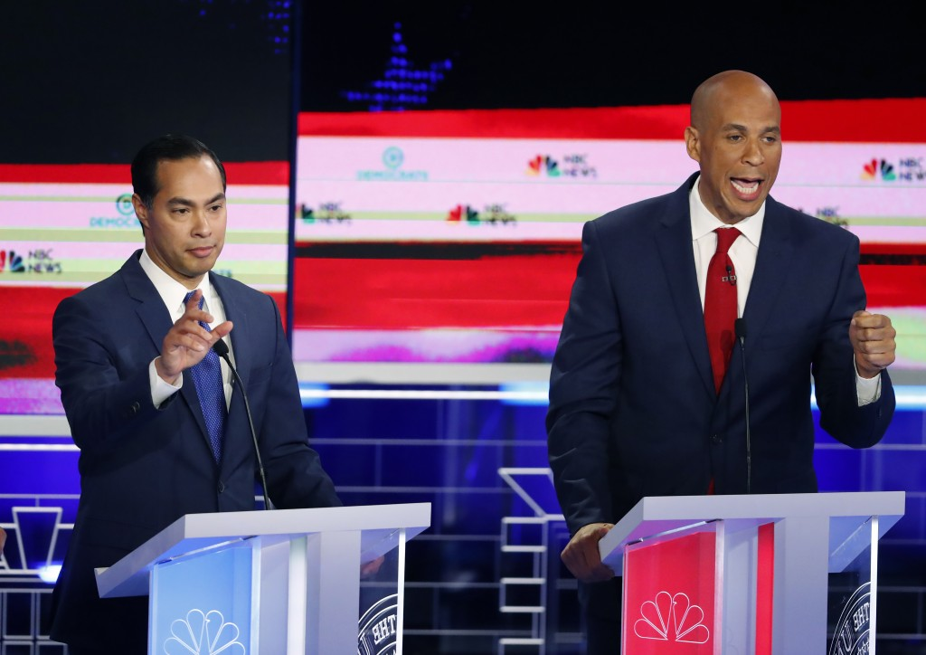 Democratic presidential candidates former Housing and Urban Development Secretary Julian Castro, Sen. Cory Booker, D-N.J.,  interrupt each other durin...