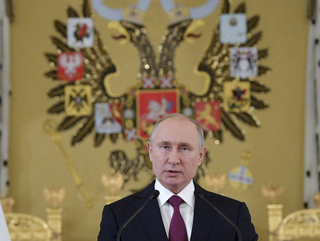 Russian President Vladimir Putin speaks during a reception for graduates of Russian military education institutions in the Kremlin in Moscow, Russia, ...