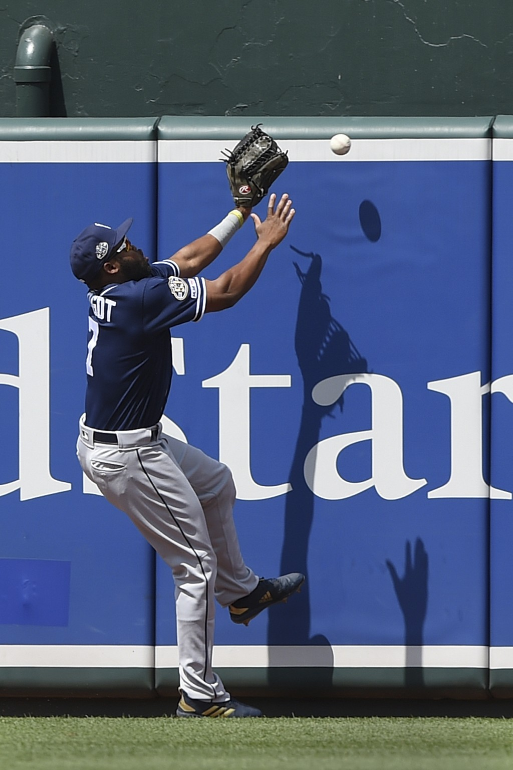 San Diego Padres' Manuel Margot reaches for a ball hit by Baltimore Orioles' Hanser Alberto in the first inning of a baseball game Wednesday, June 26,...