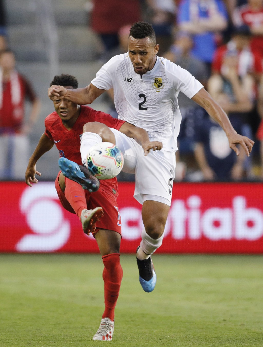 U.S. forward Jonathan Lewis (18) and Panama defender Francisco Palacios (2) viefor the ball during the first half of a CONCACAF Gold Cup soccer match ...