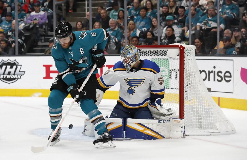 FILE - In this Sunday, May 19, 2019 file photo, St. Louis Blues goaltender Jordan Binnington (50) makes a save against San Jose Sharks' Joe Pavelski (...