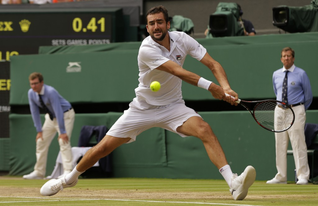 FILE - In this July 16, 2017, file photo, Croatia's Marin Cilic returns to Switzerland's Roger Federer in the men's singles final at the Wimbledon Ten...