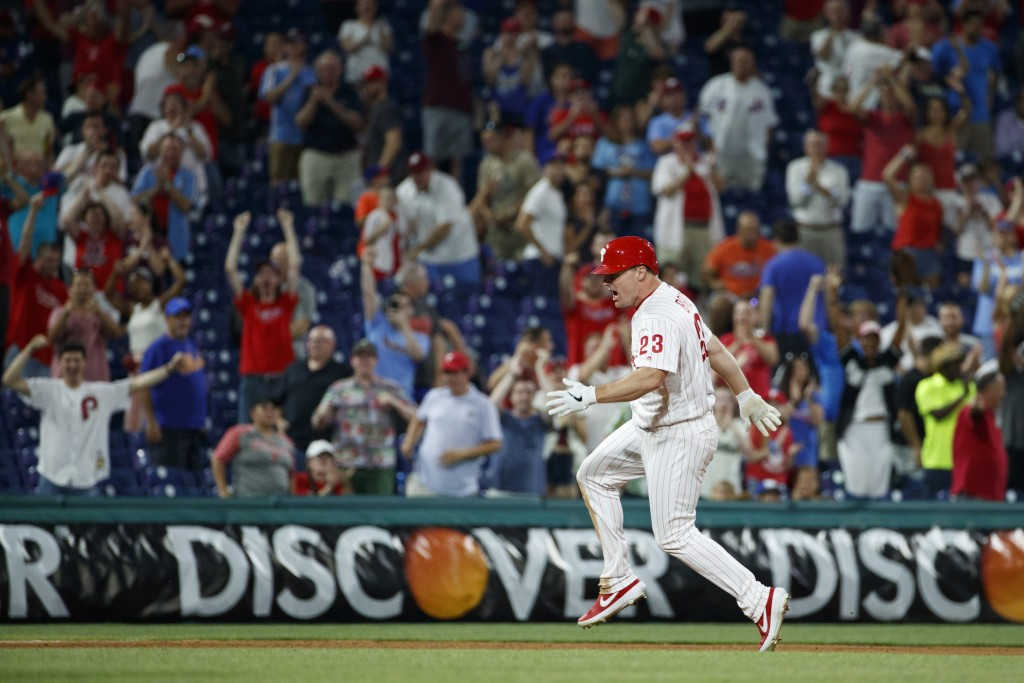 Philadelphia Phillies' Jay Bruce celebrates after driving in the winning run with a double off New York Mets relief pitcher Stephen Nogosek during the...