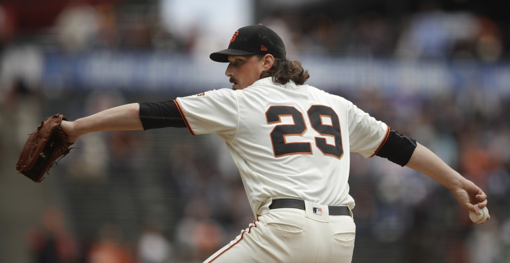 San Francisco Giants pitcher Jeff Samardzija works against the Colorado Rockies in the first inning of a baseball game Wednesday, June 26, 2019, in Sa...
