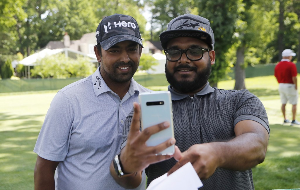 Aru Sau of Detroit, right, takes a selfie with golfer Anirban Lahiri during the Pro-Am at the Rocket Mortgage Classic golf tournament, Wednesday, June...