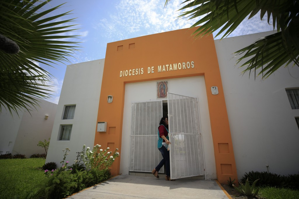 A worker enters the migrant shelter where Tania Vanessa Avalos has been receiving assistance since her husband Oscar Alberto Martinez Ramirez, 25, and...