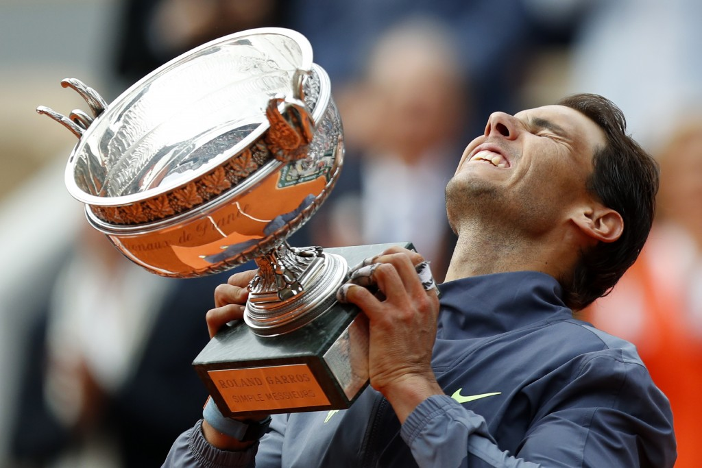 FILE - In this June 19, 2019, file photo, Spain's Rafael Nadal lifts the cup after defeating Austria's Dominic Thiem in their men's final match of the...