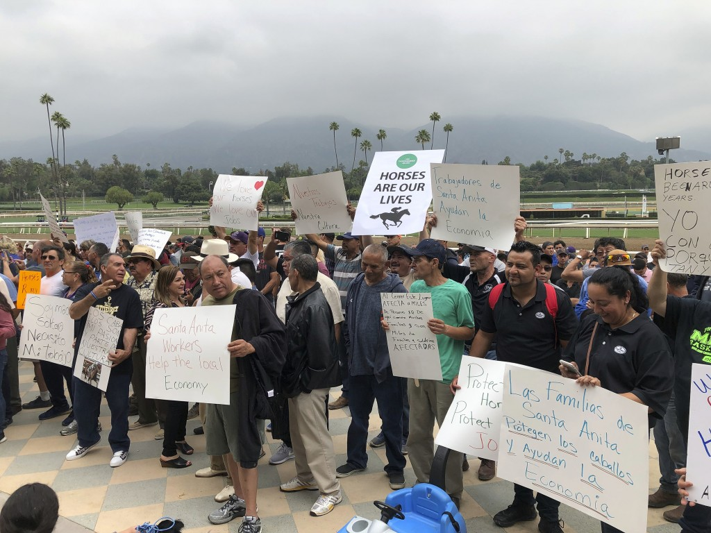 FILE - In this June 20, 2019 file photo Santa Anita Park workers hold a rally at the track in Arcadia, Calif. California Gov. Gavin Newsom signed a la...