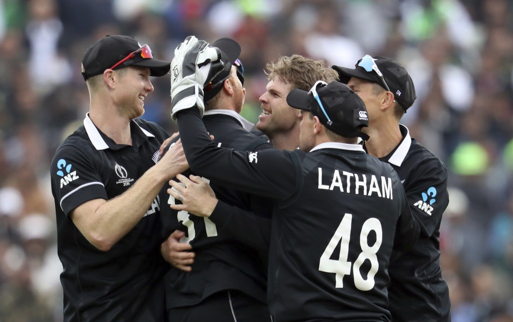 New Zealand's bowler Lockie Ferguson, centre facing camera, celebrates with teammates after dismissing Pakistan's batsman Imam-ul-Haq for 19 runs duri...