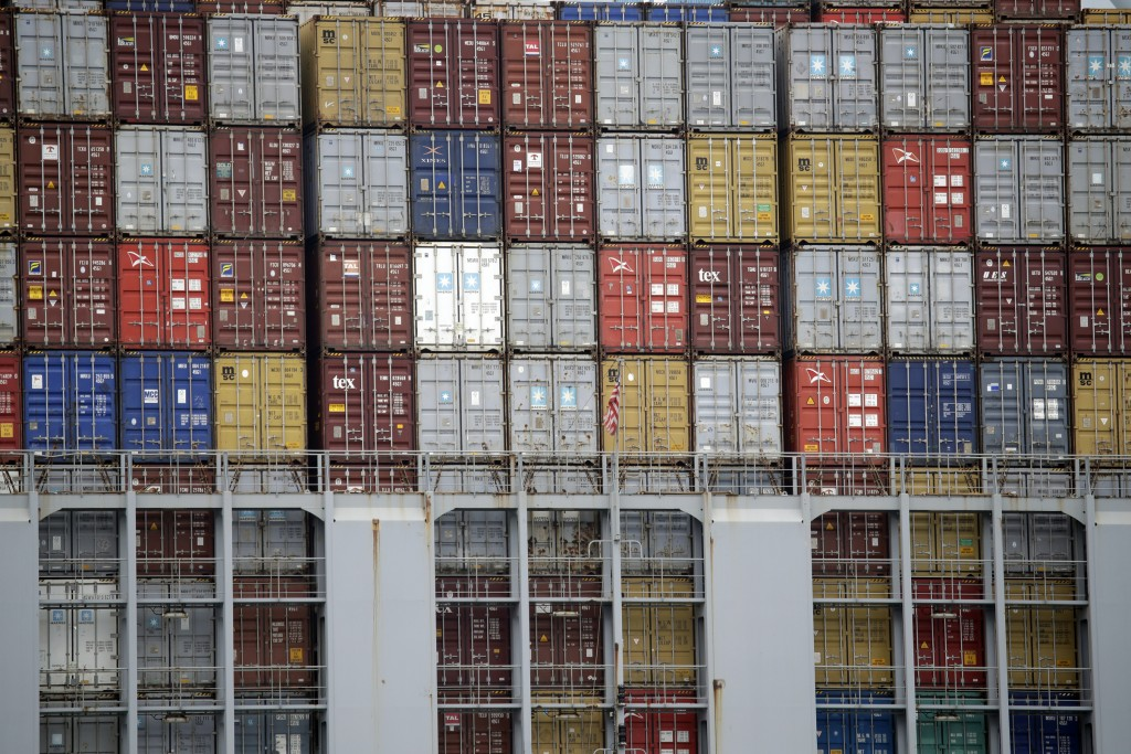 FILE - In this June 19, 2019, file photo cargo containers are stacked on a ship at the Port of Los Angeles in Los Angeles. On Thursday, June 27, the C...