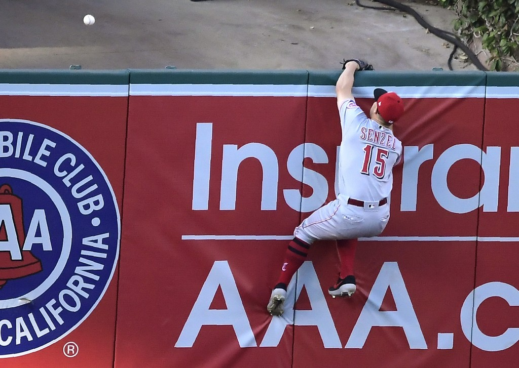 Cincinnati Reds third baseman Nick Senzel can't reach a ball hit for a solo home run by Los Angeles Angels' Justin Bour during the fifth inning of a b...