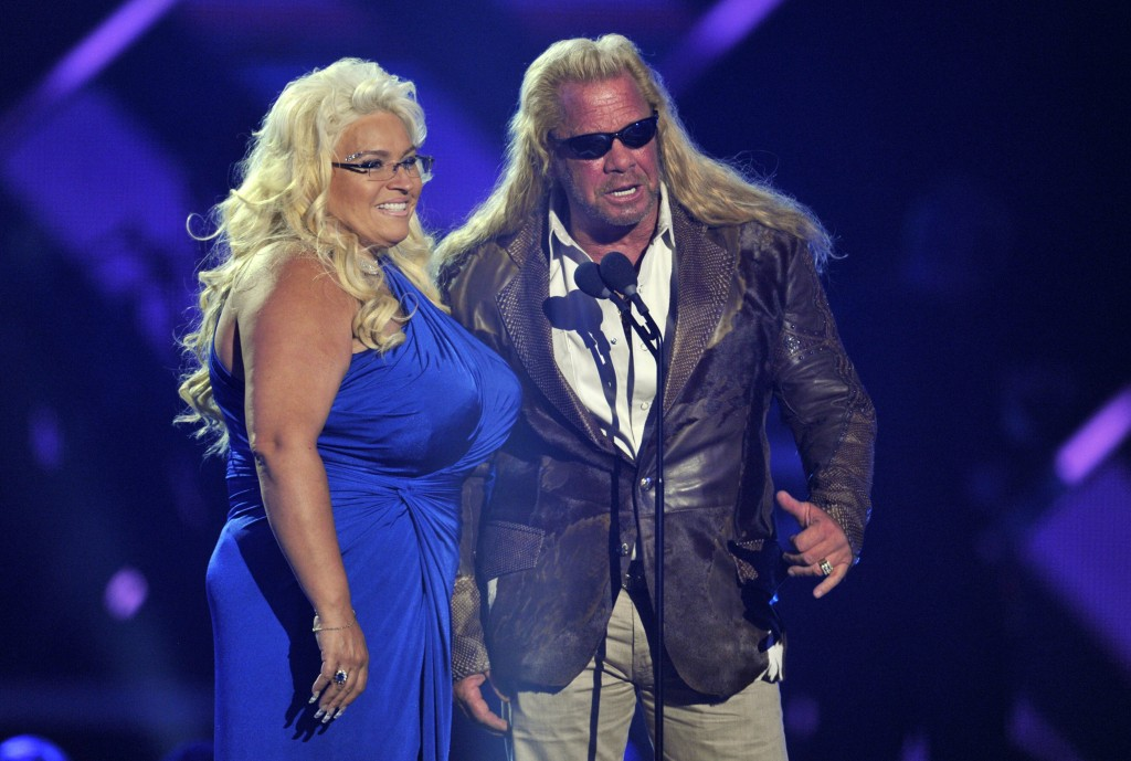 """FILE - In this June 5, 2013, file photo, Duane """"Dog"""" Chapman, right, and Beth Chapman present the award for CMT performance of the year at the CMT Mus..."""