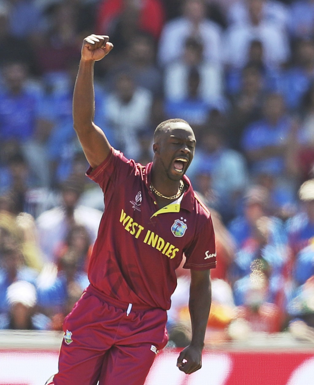 West Indies' Kemar Roach celebrates the dismissal of India's Vijay Shankar during the Cricket World Cup match between India and West Indies at Old Tra...